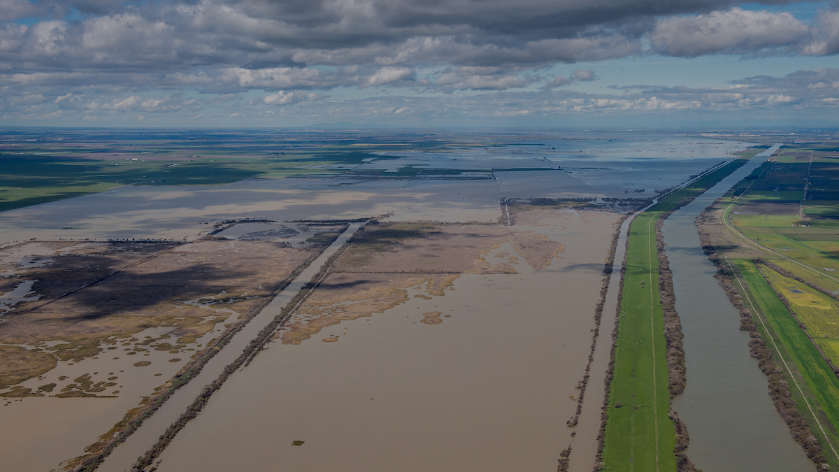 Aerial view of partially flooded land on a cloudy day in the Sacramento-San Joaquin Delta.